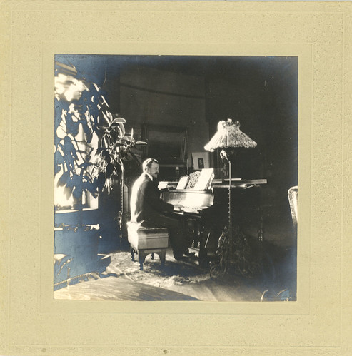 Howard Forrer Peirce at the piano, probably in the Music Room at Five Oaks