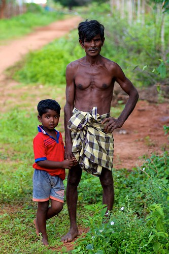 A boy and his father in the village where our well is being built