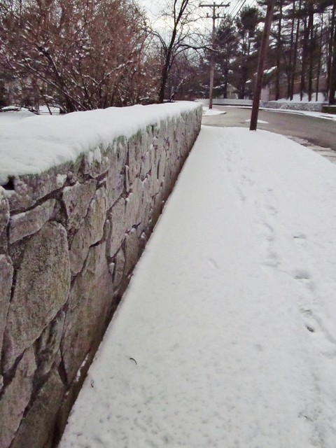 Snow on stone wall