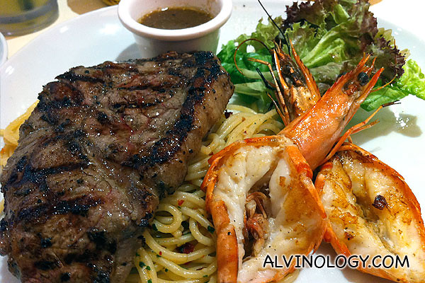 Steak with grilled prawns