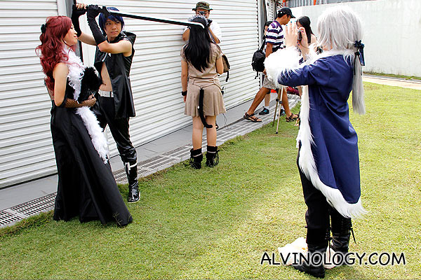 Another picture of cosplayer taking a photo of cosplayer