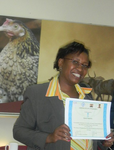 Queen Katembu of the Food and Agriculture Organisation showing off her training certificate after the workshop