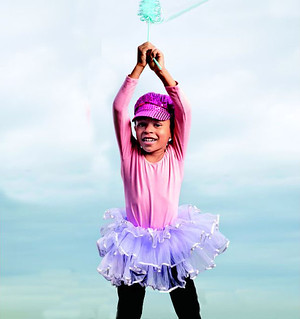 "The photo of Kilodavis' son depicts a ""princess boy"" wearing a purple tutu and a sparkly sequin hat."