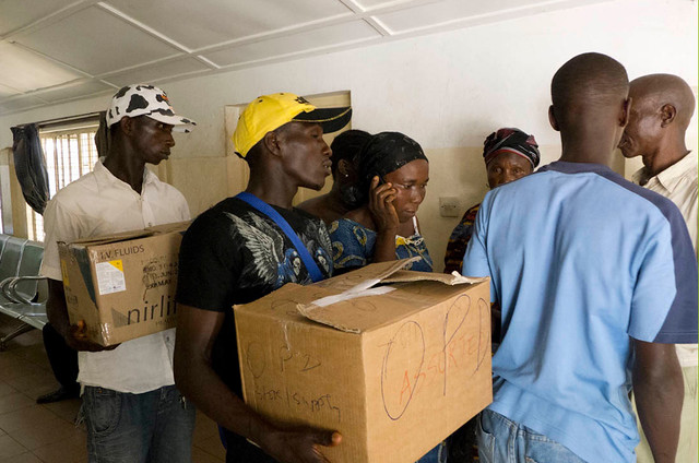 Two boxes tell a tragic tale in Freetown, Sierra Leone: a family carry away the bodies of two still-born babies in cardboard boxes. Picture: Nancy Durrell McKenna/Safe Hands for Mothers
