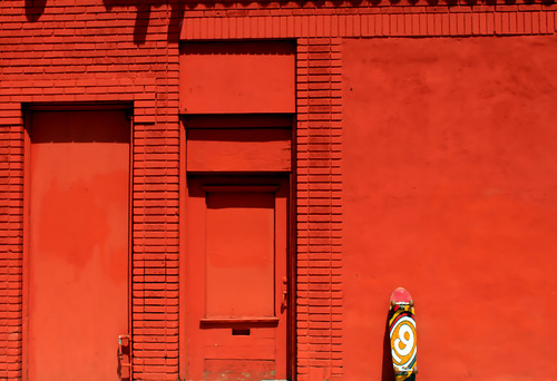 Red Wall & Skateboard by See El Photo