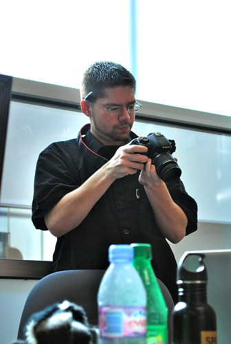 Greg Colgan checks his work while documenting the Rabble Tablet group's meeting.