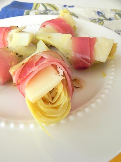 Amaretto sour and prosciutto wrapped artichoke hearts