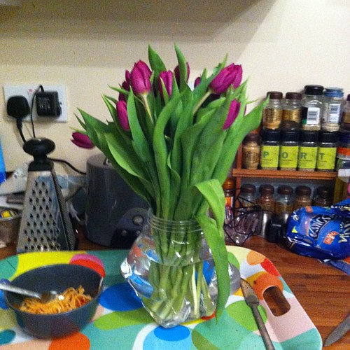 @cgbj got me tulips. Only problem not enough vases. Had to use an empty cookie jar loll
