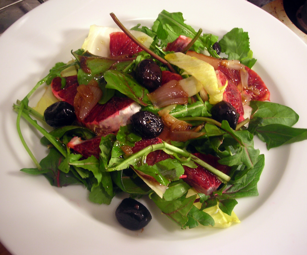 Belgian endive and Bordeaux spinach salad, with oil-cured olives, blood orange and roasted shallot vinaigrette