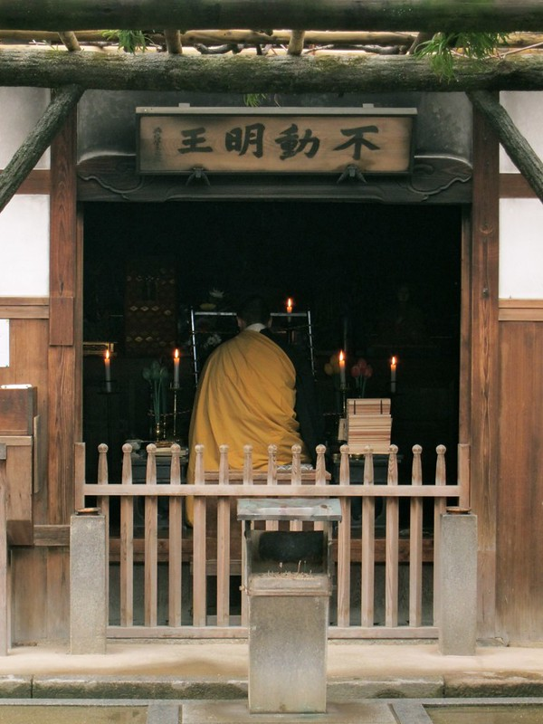 A monk offering prayer in one of the temples