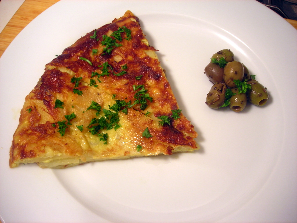Tortilla de patatas; marinated olives with herbs