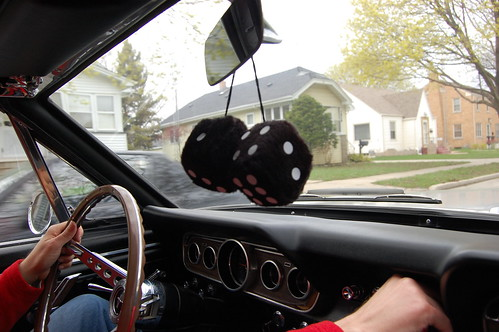 Dice are hanging from the rear view mirror