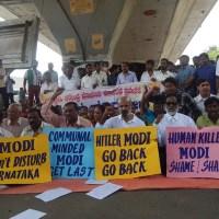 """""""Modi go back"""": Protest against Narendra Modi's Karnataka visit"""