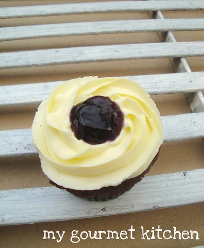 chocolate cupcake with buttercream frosting & blueberry jam