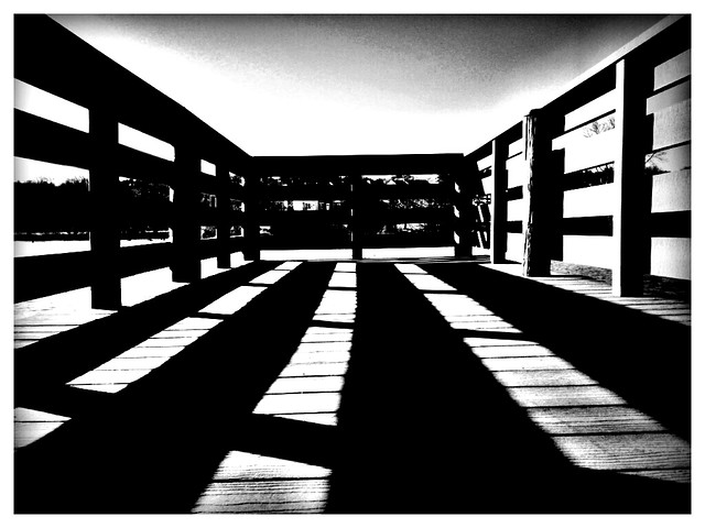 Shadow on the pier, behind the shadow, blackandwhite