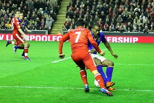 Luis Suarez runs at Distin 5