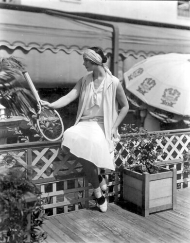 Woman models tennis fashions at Burdine's: Miami, Florida