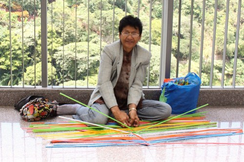 Lady Weaving Plastic Straws 2