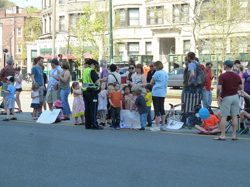 Children with homemade signs chatting to Boston Police