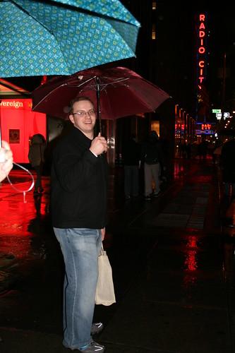 Sean walking in the rain near Radio City Music Hall