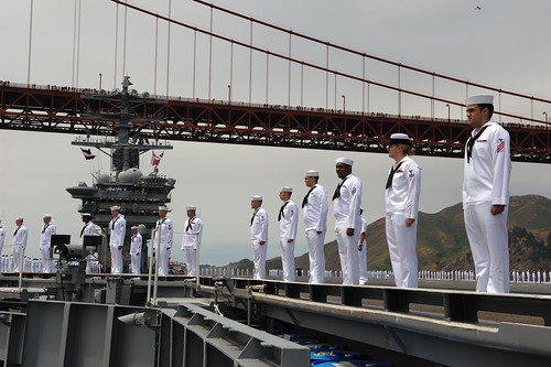 Sailors man the rails as the ship pulls into the San Francisco Bay. by Official U.S. Navy Imagery
