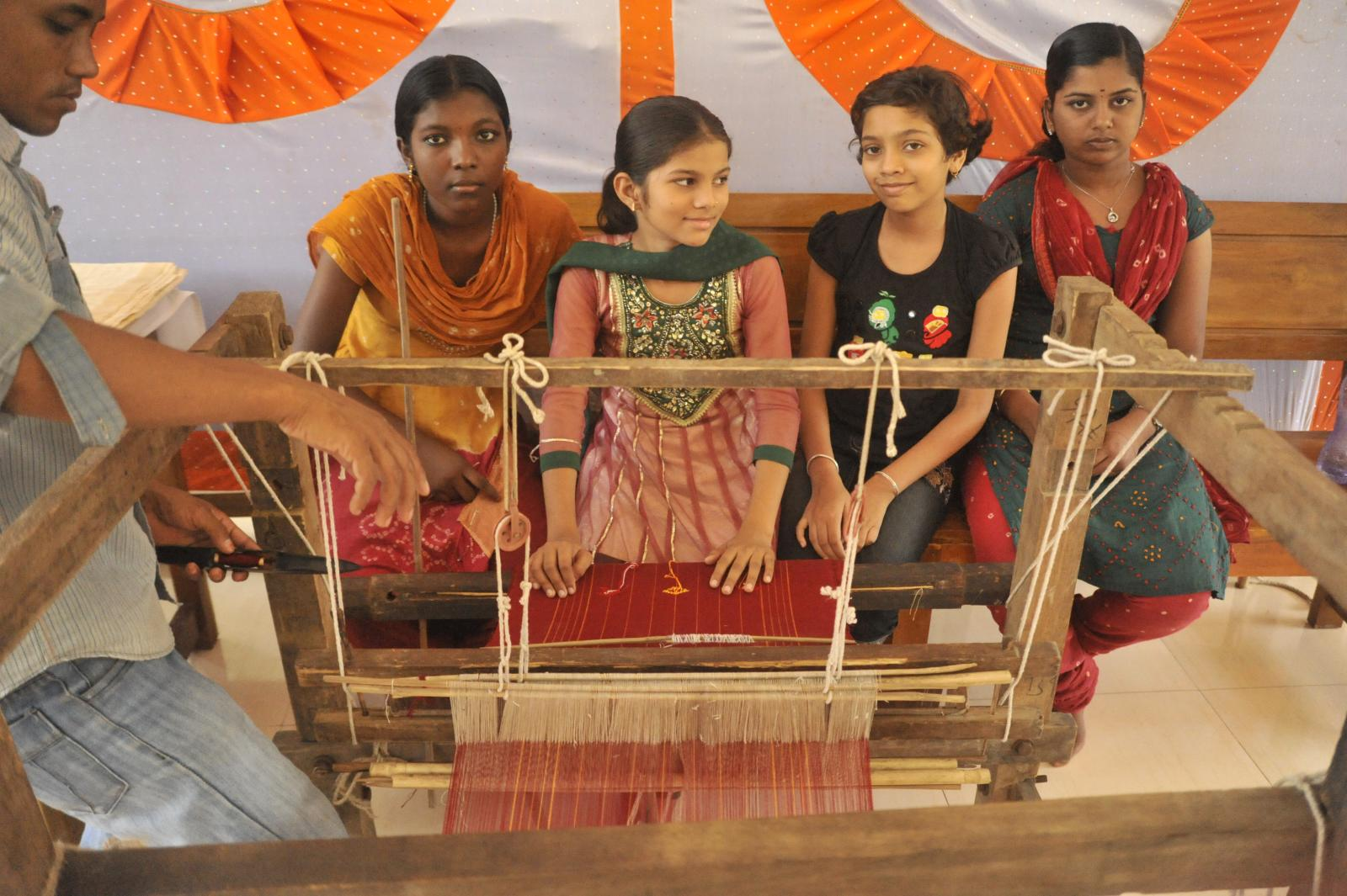 On their way to finishing their dupatta...weaving from Assam