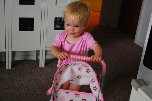 Walking with her stroller.