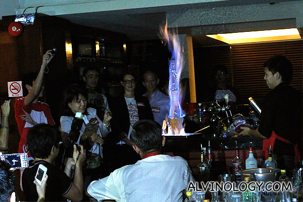 A tall flaming drink to round up the night - Happy birthday Coca-Cola!