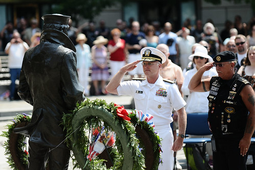 "The director of Surface Warfare (N96) for the Chief of Naval Operations, and Rolling Thunder Inc. National Veterans Rights Officer Lt. place a wreath at the Lone Sailor Memorial during the 25th ""Ride for Freedom"". by Official U.S. Navy Imagery"