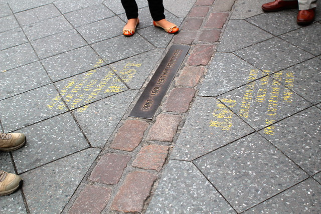 Cobblestones mark where the wall was.