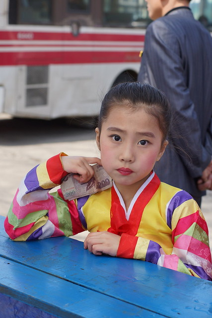 North Korean Girl with Currency