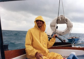 Dave Bricker at helm of Blue Monk in Abaco 1990