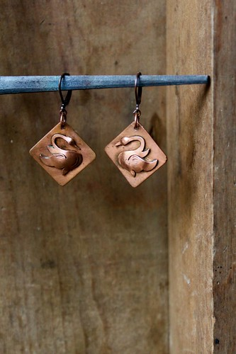 handmade copper swan earrings by denise carbonell