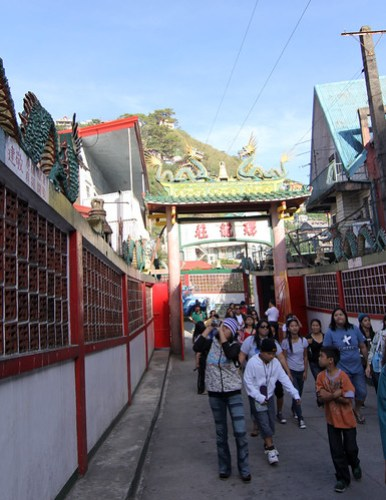 Group of tourists flock inside the Bell Church in Baguio