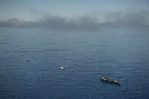 U.S. Navy ships transit the Pacific Ocean. by Official U.S. Navy Imagery
