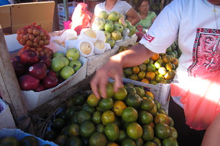 buying oranges at the market in balige
