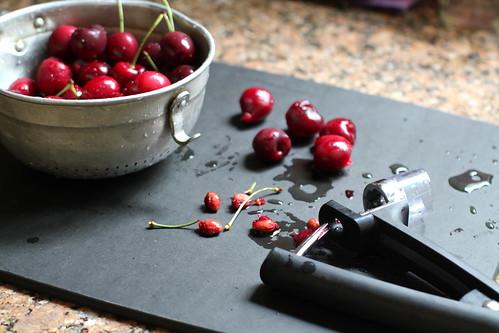 pitting the cherries