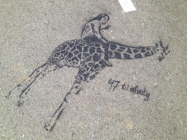 """47 til infinity"" girl and giraffe sidewalk stencil"