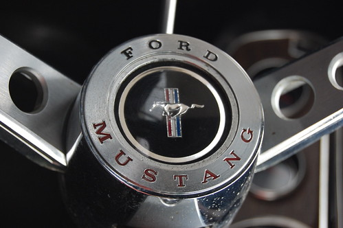 Logo and Ford Mustang engraved on metal center of steering wheel