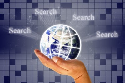 """Globe on crossword background surrounded by """"Search"""""""