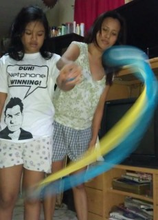 Teaching her how to poi