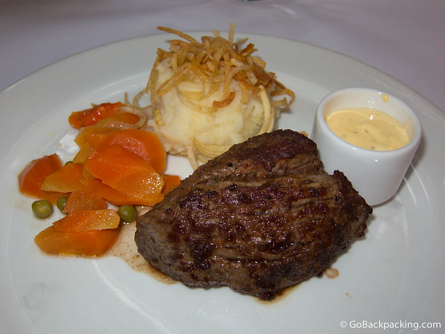 Filet mignon with Bernaise sauce, mashed potatoes, and vegetables