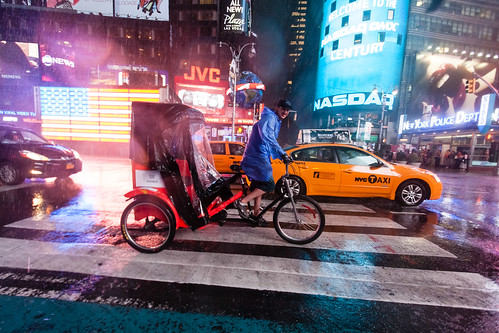 Bicycle-cab in Times Square storm by Dan Nguyen @ New York City