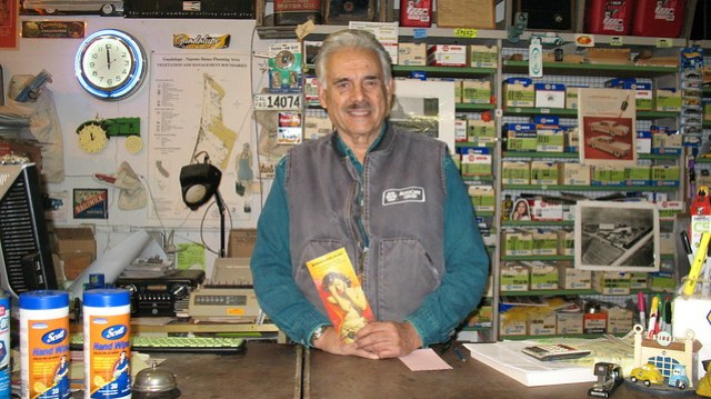 John Perry holds an Esotouric flier inside his Napa Auto Parts Store IMG_4949