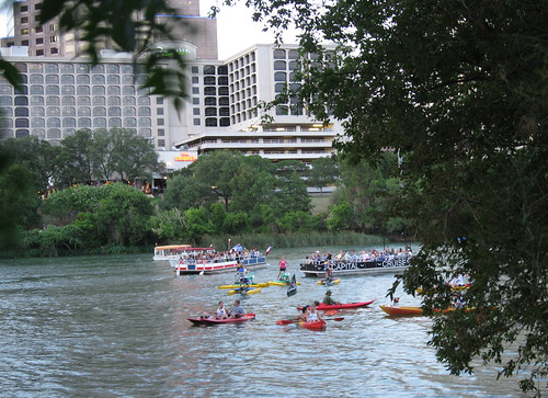 Various boats on the river waiting for the evening's bat flight from the Congress Ave Bridge