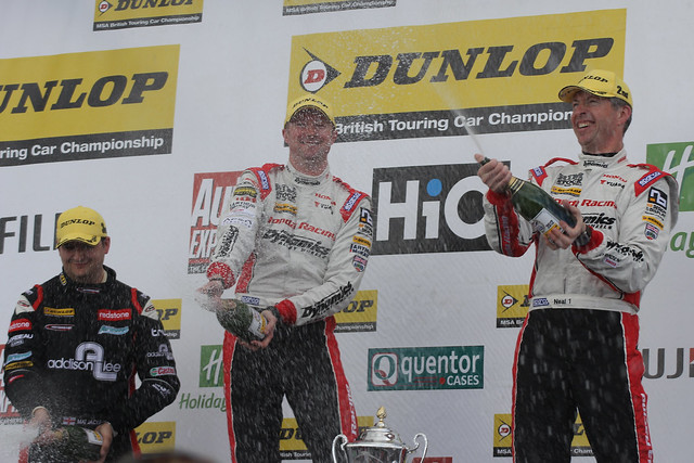 Gordon Sheddon, Matt Neal and Mat Jackson celebrate their top three places on the podium at the BTCC race at Donington Park in April 2012
