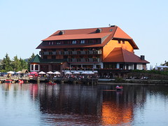 """the mountain hotel on """"Mummelsee"""" on a summer day"""