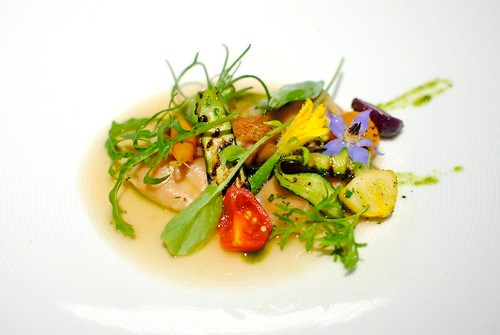 Truffled Foie Gras Agnolotti Crisp Chicken Oyster, Summer Vegetables, Toasted Pistachio Consomme