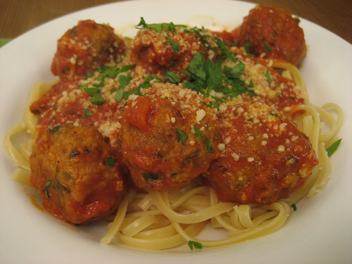 spaghetti and meatballs, all covered in cheese
