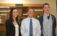 Commissioner Bowen poses with Brewer High School students Erica Davis and Travis Langtin after discussing school accountability with them and other students on Dec. 8 in Bangor.